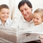family-reading-newspaper-home-happy-father-daughter-son-49661834